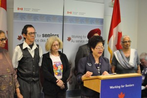 The Honourable Alice Wong, Minister of State for Seniors speaking at the press conference on June 10th., Click to enlarge and to access description.