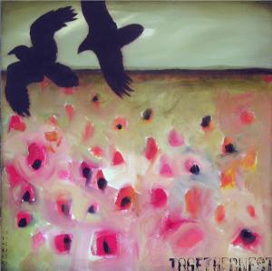 Two birds flying in a field of flowers