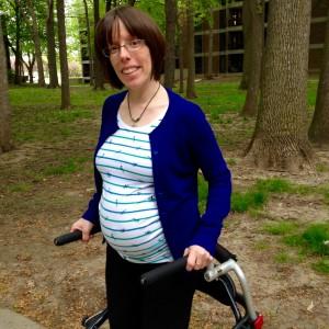 Isabelle Boisvert pregnant in a park.