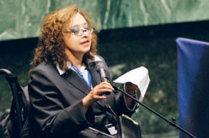 A woman with disabilities talking in the United Nations